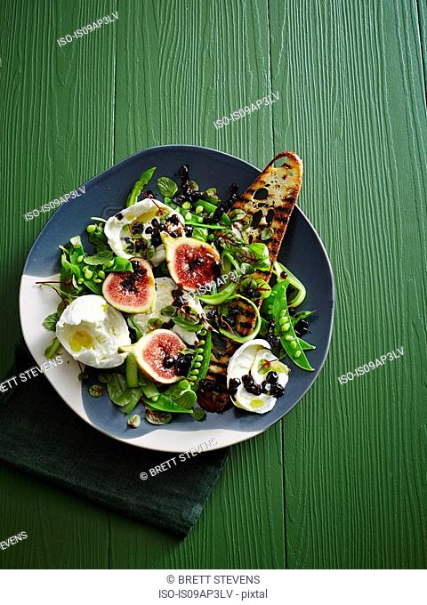 Plate of pea Salad - figs, balsamic glaze, burrata, micro herbs, asparagus and grilled sourdough bread