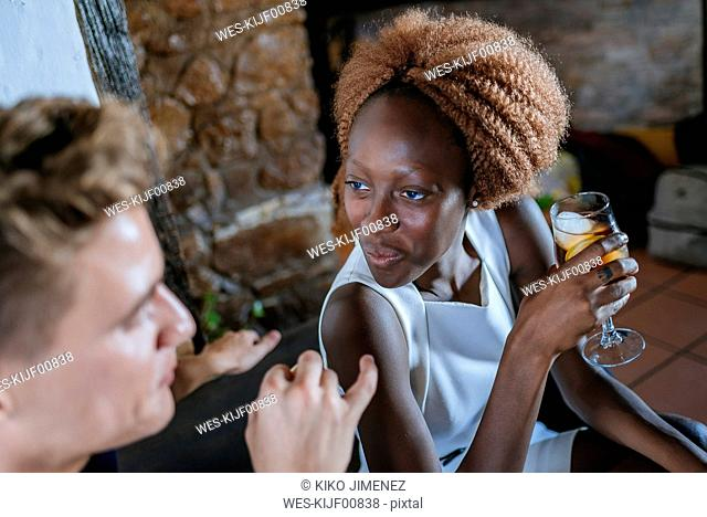 Young woman looking at her boyfriend in a bar