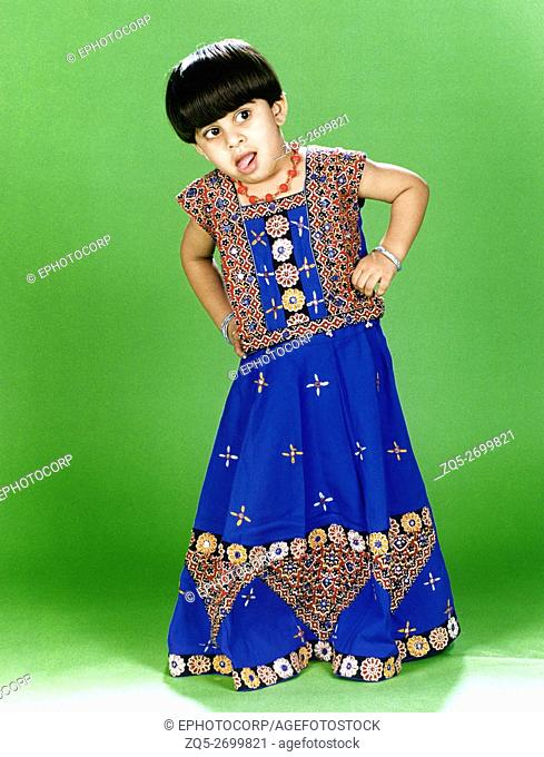 A little girl wearing an embroidered 'ghagra choli', a traditional Indian attire