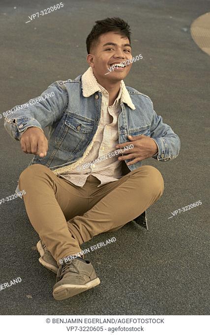 young man sitting on floor, vibrant, vital, energised, motivated
