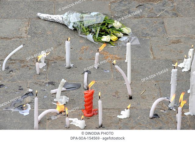 Flowers and Candles outside the Taj Mahal hotel ; after terrorist attack by Deccan Mujahedeen on 26th November 2008 in Bombay Mumbai ; Maharashtra ; India