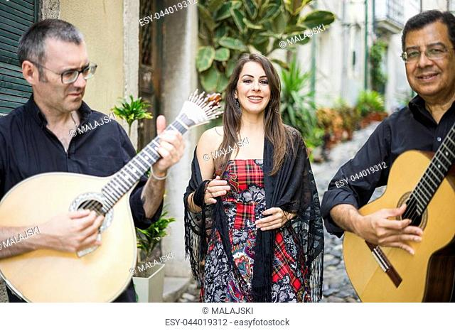 Fado band performing traditional portuguese music on the street of Alfama, Lisbon, Portugal