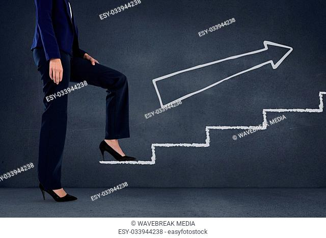 Business woman climbing stairs against blue background with white arrow