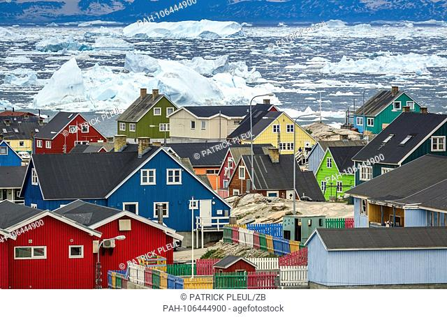 28.06.2018, Gronland, Denmark: Colorful houses of the coastal town of Ilulissat in western Greenland. The city is located on the Ilulissat Icefjord