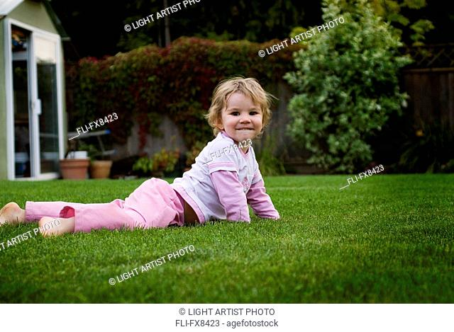 Little Girl Laying in Grass in Backyard, Langley, BC