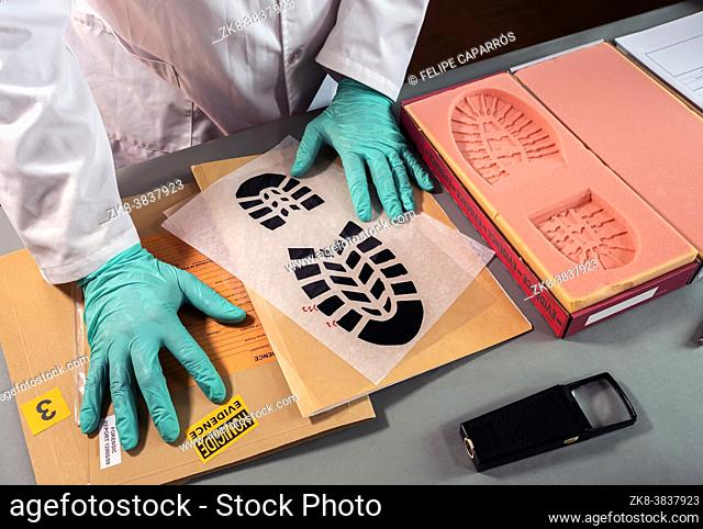 Forensic scientist impatient because he can't find similarity in shoe sole prints in crime lab, concept image