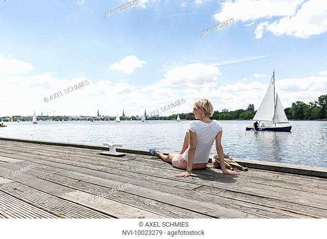Woman enjoying view of alster lake at Winterhude, Hanseatic City of Hamburg, Germany