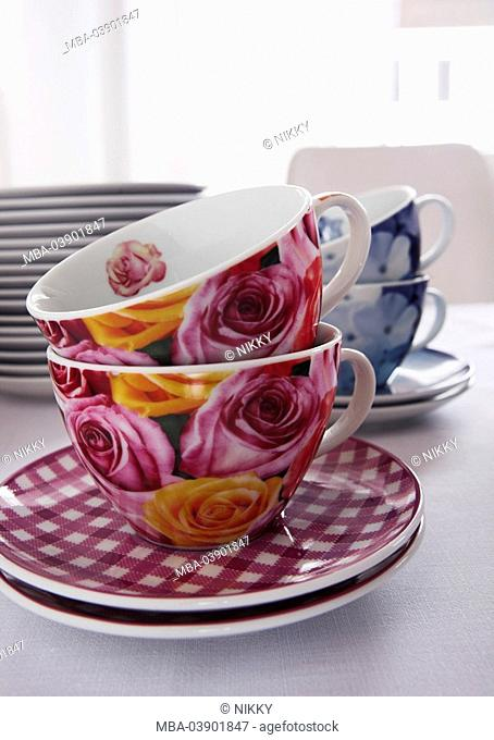 Dining table, coffee-dishes, coffee-cups, plate-stack