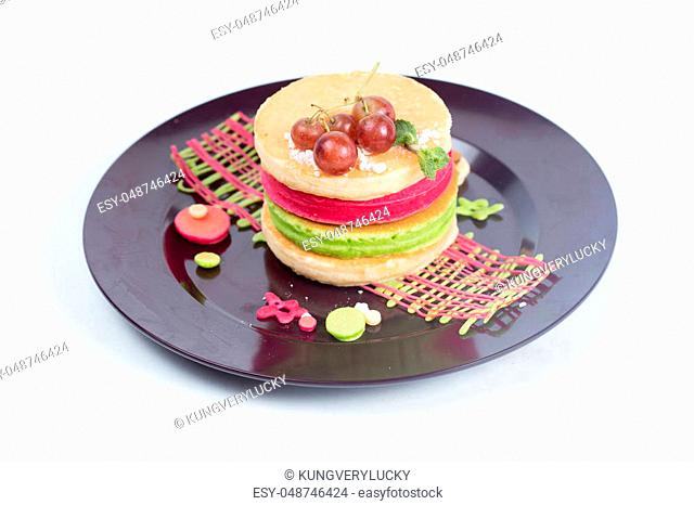 Grape and colorful pan cake sandwich onplate