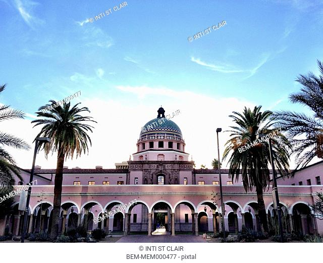 Palm trees by ornate domed building, Tucson, Arizona, United States