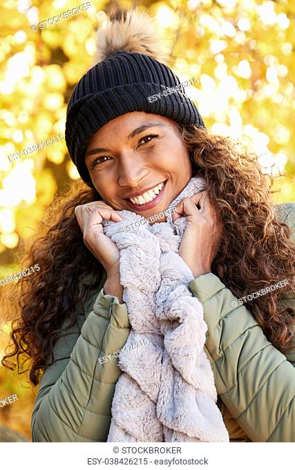 Outdoor Portrait Of Smiling Woman Wearing Scarf In Autumn