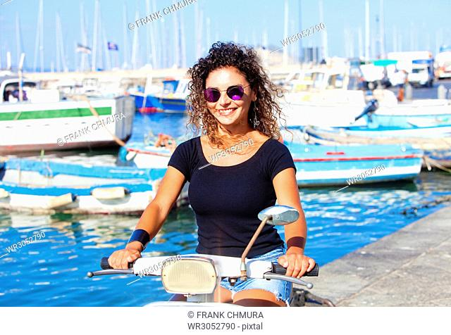 Young Italian Woman on Scooter Smiling