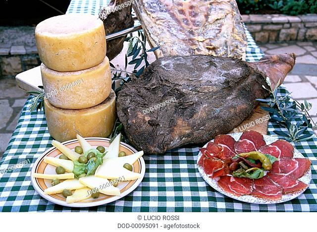 Croatia, Dalmatinski prsut a paski sir, whole and sliced seasoned and smoked Dalmatian ham, sliced sheep's cheese
