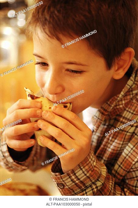 Child eating crepe, close-up