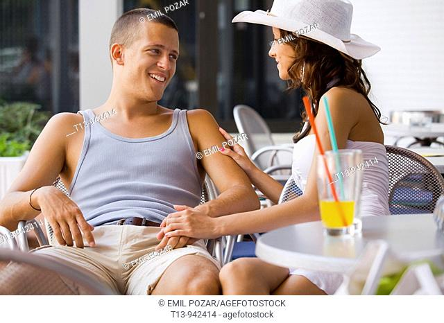 Young couple happy alone in bar