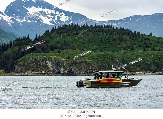 A boat passes by in Kukak Bay, Katmai National Park & Preserve, Southwest Alaska, USA