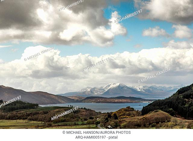 Large white clouds over scenic landscape of Cuillin mountain range and Isle of Skye, Scotland, UK