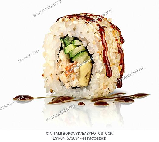 Closeup sushi roll california food isolated on white background. Sushi roll with eel, vegetables and unagi sauce. Reflection