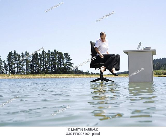 A woman at her desk on top of water