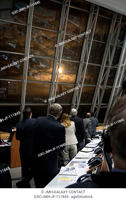 NASA managers watch the liftoff of space shuttle Endeavour through the windows of Firing Room 4 in the Launch Control Center at NASA's Kennedy Space Center in...