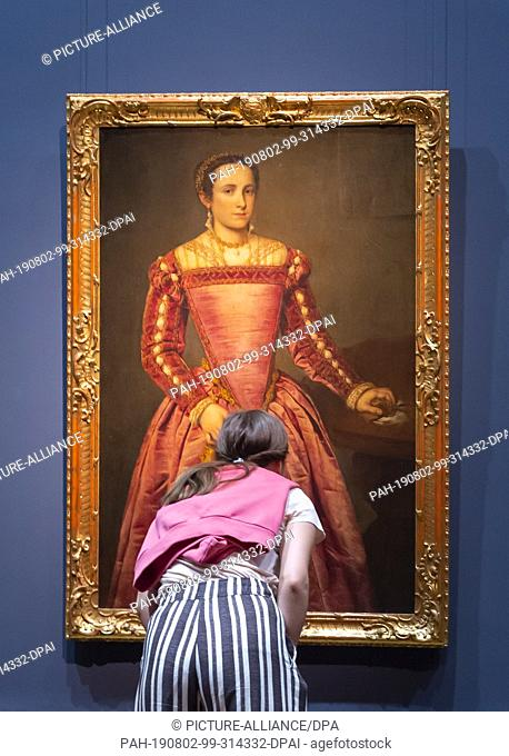 """02 August 2019, Saxony, Dresden: A visitor looks at the work """"""""Lady in Red Dress"""""""" by Giovanni Battista Moroni in the exhibition """"""""Highlights of the Old Masters..."""