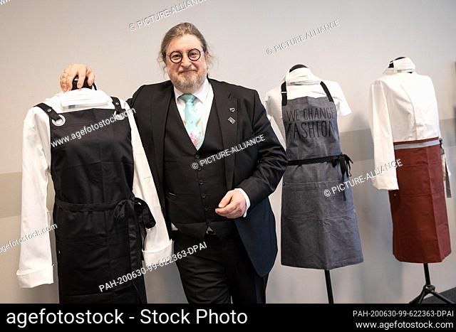 30 June 2020, Hamburg: Dirk Iserloh, Chairman of the Supervisory Board of the Dorint Hotel Group, stands between a selection of new textiles for his hotel at a...