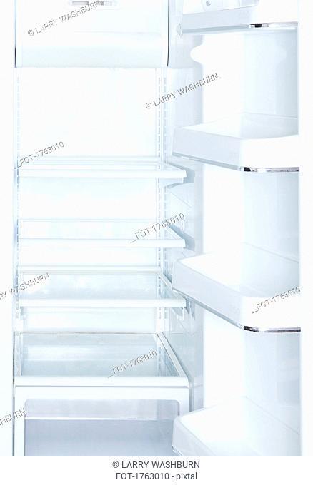 Empty, open white refrigerator