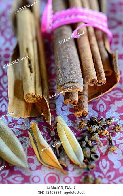 Cinnamon sticks and various spices