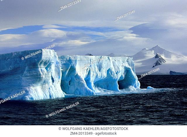 ANTARCTICA, TABULAR ICEBERG WITH CAVES & ARCHES, MT. BRANSFIELD, ANTARCTIC PENINSULA BACKGROUND