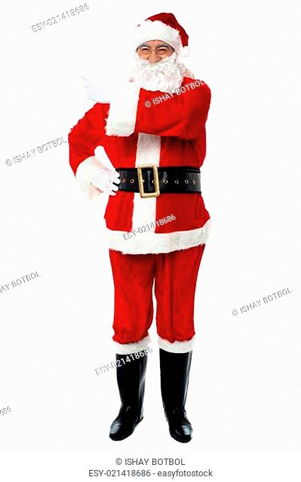 Father Santa pointing towards the copy space area