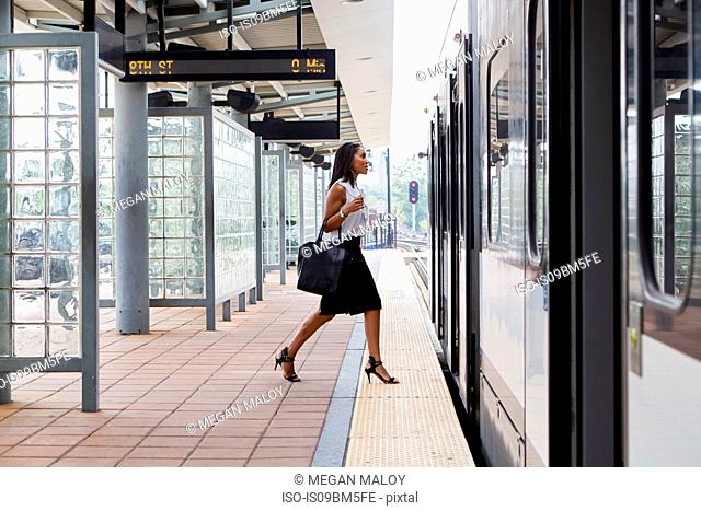 Businesswoman boarding train