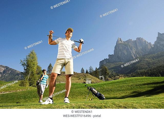 Italy, Kastelruth, Golfers on golf course