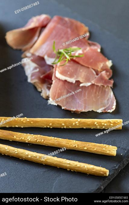 Italian ham served with grissini