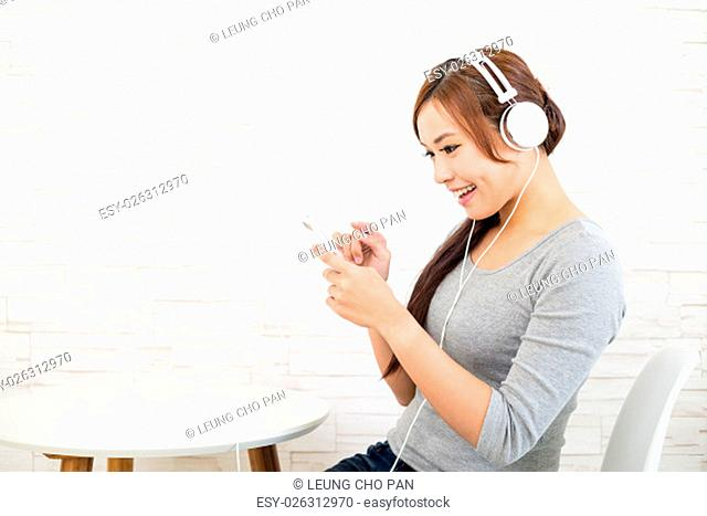 Woman listen to song with music player