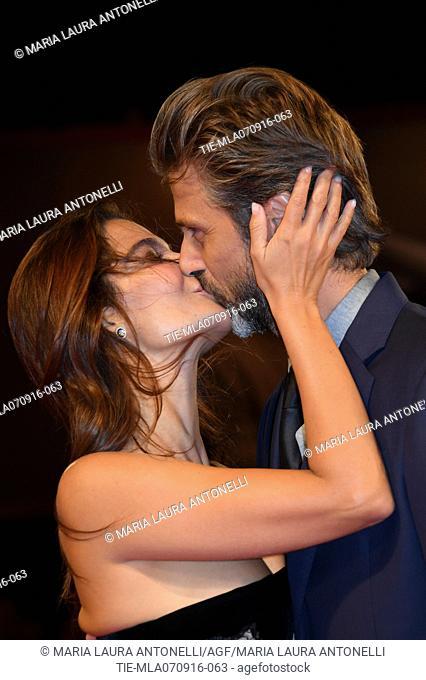 Ilaria Spada kissing the director Kim Rossi Stuart during the red carpet of film Tommaso at 73rd Venice Film Festival, Venice, ITALY-06-09-2016