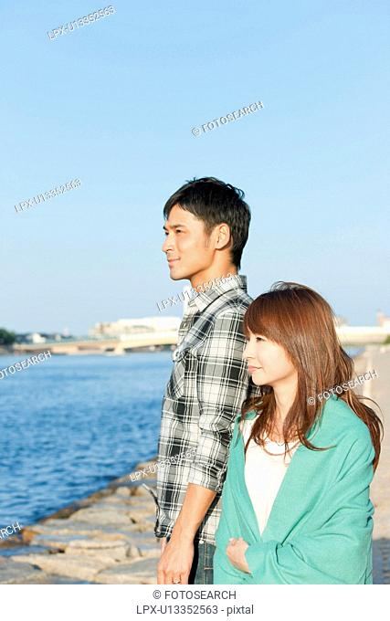 Young couple looking away, Hyogo Prefecture, Honshu, Japan