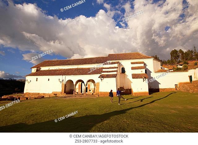 Tourists in front of the church at the town center, Chinchero, Valle Sagrado, Cusco, Peru, South America