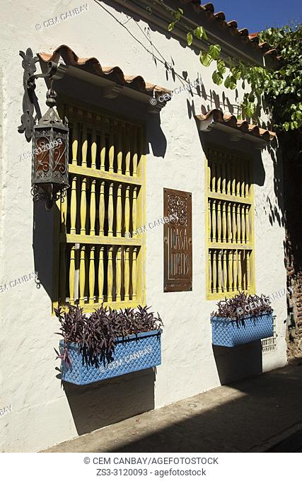 Colonial building covered with flowers at the historic center, Cartagena de Indias, Bolivar Region, Colombia, South America