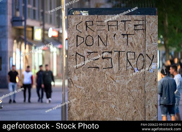 """dpatop - 21 June 2020, Baden-Wuerttemberg, Stuttgart: The words """"""""Create don't Destroy"""""""" are written on wooden panels covering a damaged panel of a billboard"""