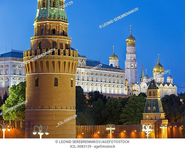 Towers of Moscow Kremlin illuminated at dusk. Moscow, Russia