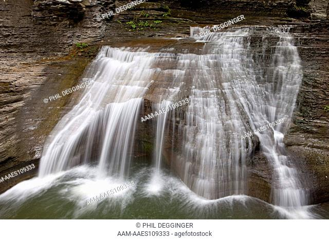 Buttermilk Falls State Park; Buttermilk Creek as it cascades dropping about 500 feet along the trail. Buttermilk Falls State Park takes its name from the...