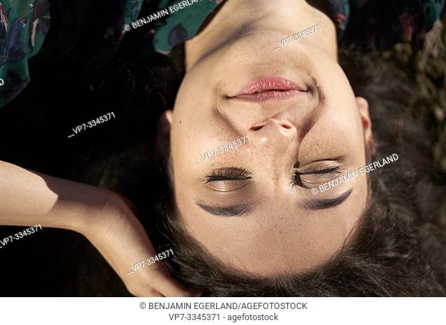 headshot of content woman wrong way round