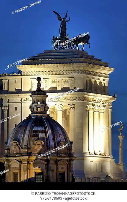Rear view of the Altare della Patria with the dome of Santi Luca e Martina, Rome Italy