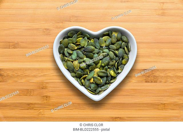 Heart-shaped bowls of heart-healthy seeds