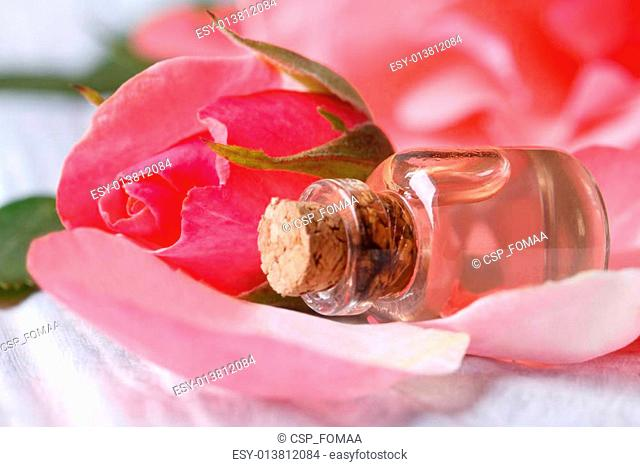Rose water from petals of pink roses