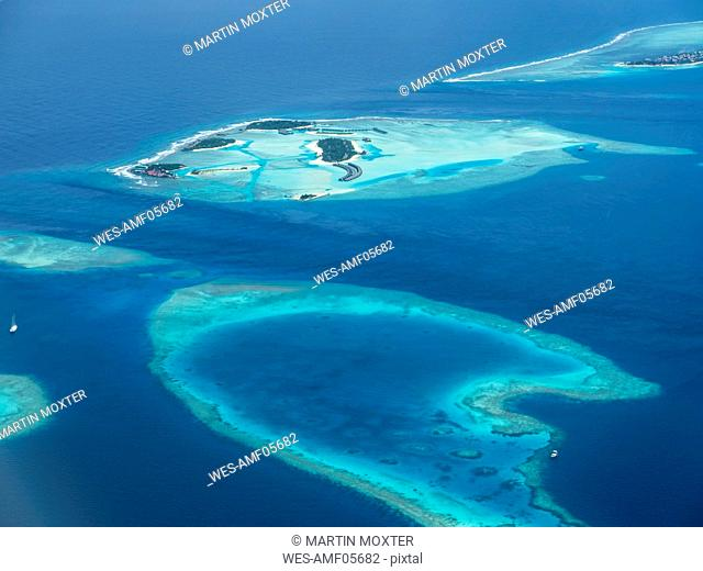 Maledives. Ross Atoll, Aerial view of island group and coral reefs