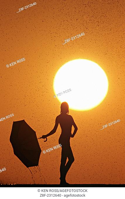 Silhouette of Woman with Umbrella, Arizona, Model Released
