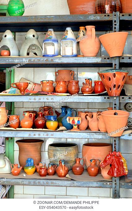 Shelf of potteries of all kind in a business