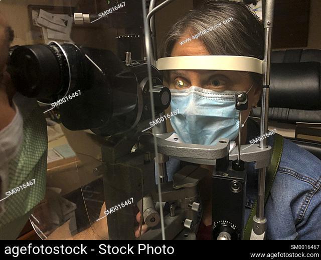 Mature woman gettin an eye exam by ophtalmologist
