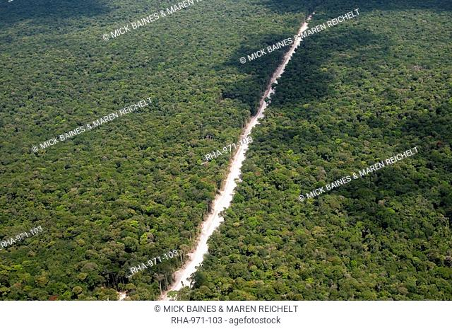 Main highway of Guyana cutting through the rainforest, Guyana, South America